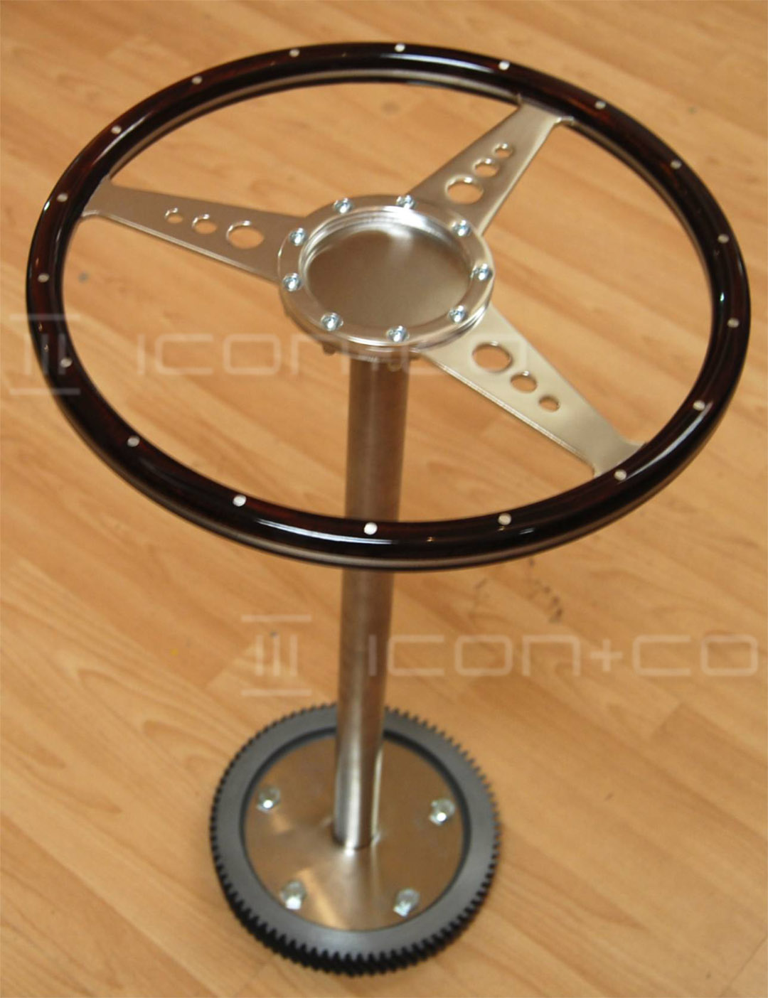 Men's fashion steering wheel display prop, Classic car themed retail display prop, steering wheel, gentleman's clothing tie display spinner, pos, VM, visual merchandising solutions, dunhill masculine window, cogs, gear wheel, cast moulded prop